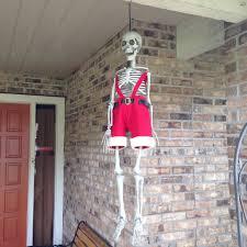 my neighbor still has a skeleton halloween decoration up rebrn com
