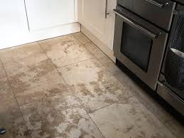 renovating a badly stained and marked travertine tiled floor