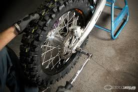 what is a motocross bike dirt bike axle and chain adjustment motorcycle usa