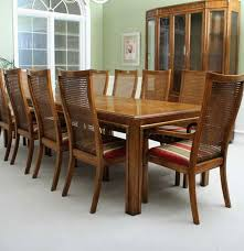 vintage drexel campaign style dining table with ten chairs ebth