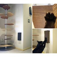 modern wall hanging brushed steel and cardboard cat scratcher from