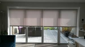 Venetian Blinds For Patio Doors by Electric Blinds Covering Your Bifold Doors Will Reduce Unwanted