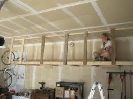 build overhead hanging storage in your garage you can do it