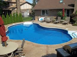 Swimming Pool Furniture by Swimming Pool Round Swimming Pool Design With Travertine Tiles