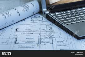 architects roll of 2d modern new house plan with laptop 2ds of a