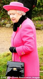 queen handbag lipstick a crisply folded 10 note and a portable hook the secrets