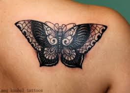 glamorous black and white detailed butterfly on shoulder