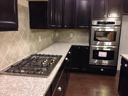 Kitchen Range Backsplash Mahogany Granite Countertops With Eased Edges Sandalo Tile On The