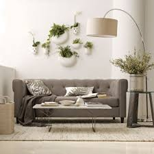 interior design with hanging planters and flower pots