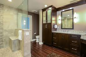 master bathroom with dark brown wooden cabinets this master