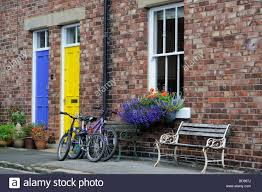 durham city yellow and blue door with two bikes outside the front
