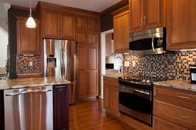 furniture brown yorktown cabinets with mosaic tile backsplash and