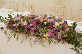 pink purple and lilac top table arrangement table centres