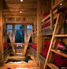 cow hide rugs with rustic kids and red duvet built in bunk bed