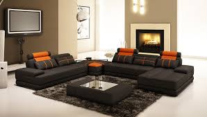 l shaped black leather couch connected by black wall theme and