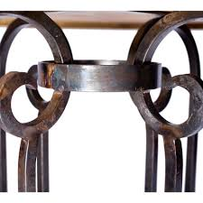 curled leg iron dining table with 48 in hammered copper top
