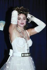 9 of madonna u0027s most iconic looks including that cone bra and her
