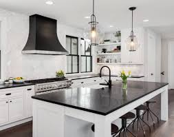 white kitchen cabinets with black countertops black countertops and white cabinets maestro surfaces