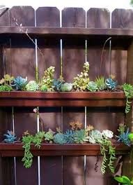rain gutters as planters great idea thank you to whoever created