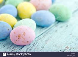pastel easter eggs small chocolate pastel easter eggs on vintage light blue wooden