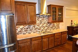 kitchen ideas with brown cabinets gorgeous kitchen backsplash glass tile rajasweetshouston com