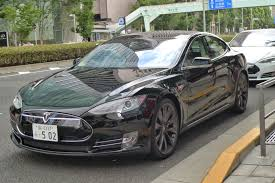 tesla outside tokyo belly gaienmae isami sushi tiny friendly old skool