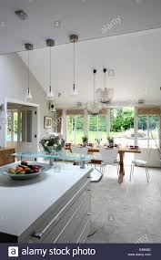 pendant lighting above island unit in large modern openplan