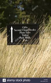 sign pointing the way to gifts plant sales and toilets at melford