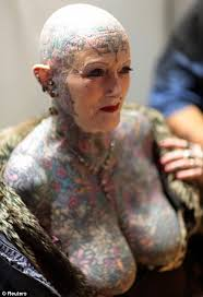 old people with colorful body tattoos in 2017 real photo
