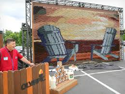 lowe s and olympic paint set new world record a mosaic of two adirondack chairs facing the sunset achieved the title of the world s largest paintbrush mosaic thanks in part to lowe s customers and