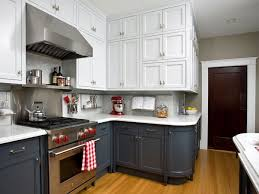 kitchen black gas stove under silver shelf near hoods between two