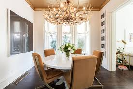 a family friendly victorian house that blends warmth and modern an antler chandelier lends an organic touch in the sleek nbsp dining room of a san
