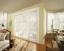 wide white horizontal blind window treatment idea for large window