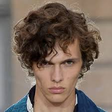 a side part with long hair and a swoop and a cross 5 modern side part hairstyles for men