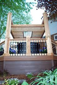 this dynamic multi level deck features a chunky pergola and