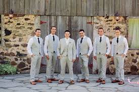 light gray suit brown shoes light gray groomsmen suits with dark gray ties and brown wingtip shoes