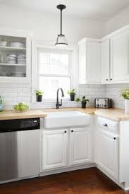 white cabinets with butcher block countertops 10 most popular kitchen countertops butcher blocks open shelves