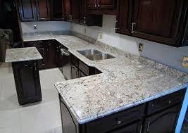 river white granite with dark cabinets white spring granite with dark countertops png