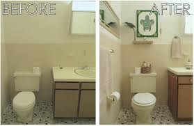 bamboo wall covering bathroom bamboo wood white ceramic bathroom apartment rental bathroom makeover before after repurposing thrift store tropical island hawaiian polynesian decor yellow green bamboo forest wall mural