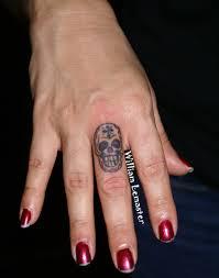 mini sugar skull on finger tattoobite com sugar skull