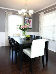 dining table chair rail molding divides two toned walls in this