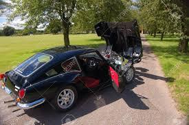 black nissan sports car british classic sports car 1960s 60s black triumph gt6 spitfire