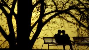 lovers on a park bench pray like a gourmet
