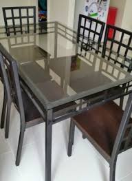 glass and metal dining table glass top wrought iron dining tables bourne