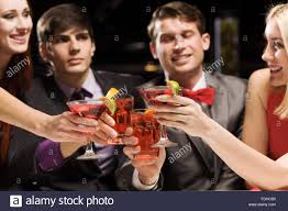 young attractive people of four having cocktail party stock photo