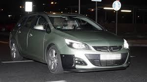 vauxhall usa opel astra facelift spied at night almost undisguised