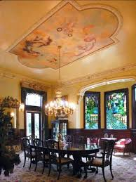 victorian style dining room with painted ceiling art and