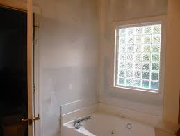 need help bathroom towel storage ideas for around garden tub
