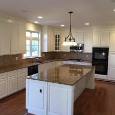 white dove on kitchen cabinets oak cabinets to white dove complete cabinet refinishing