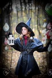 small in a witch halloween costume stock photo picture and
